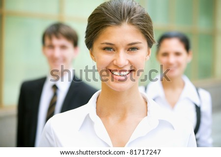 Young business lady and her team - stock photo