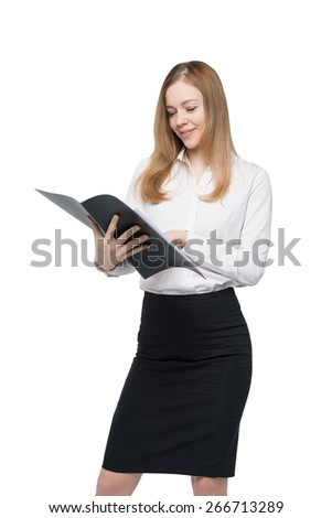 Young business lady is looking at the file. Isolated.