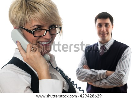 Young business lady talking by mobile phone at isolated background - stock photo