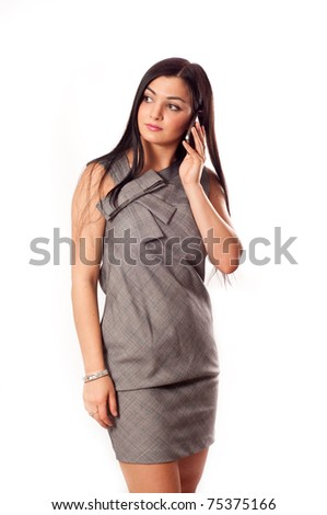 Young business lady with mobile phone - stock photo