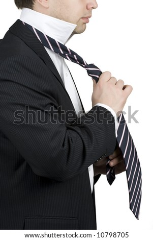Young business man adjusting his tie - stock photo