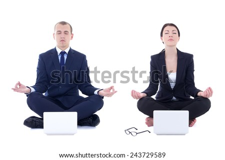 young business man and beautiful business woman sitting in yoga pose with laptops isolated on white background