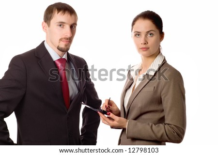 Young business man and woman working on a pda (isolated on white) - stock photo