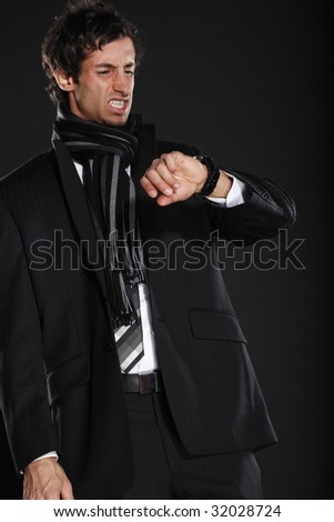 Young Business Man Angry at Watch - stock photo