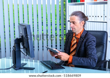 young business man at his desk working