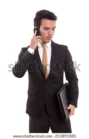 Young business man at the phone, isolated over white