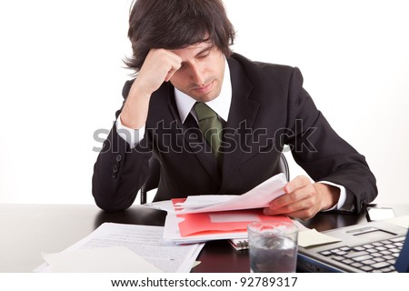 Young business man at work, isolated over white - stock photo