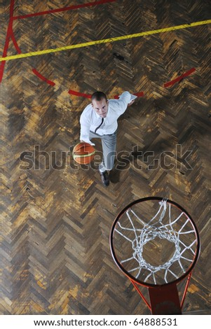 young business man basket player hold basketball ball and representing success and retirement in sport like also sports management concept - stock photo