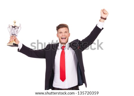 young business man cheering with a cup in one of his hands. isolated on white background - stock photo