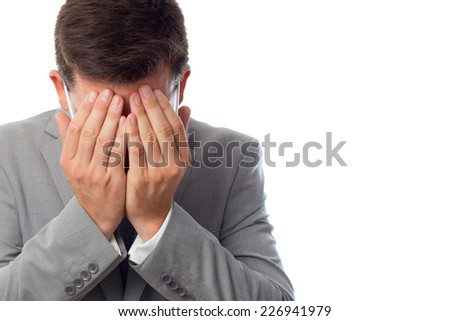 Young business man close up over white background. Looking sad - stock photo