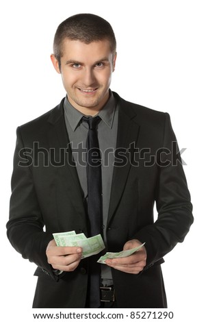 Young business man counting Euro money over white background - stock photo