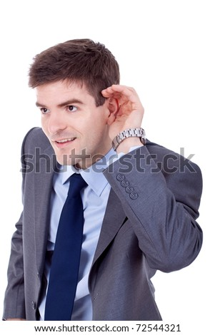 Young business man cupping hand behind ear on white background - cant hear you concept - stock photo