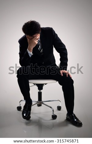 Young business man depressive, Isolated on grey background