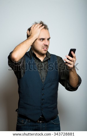 young business man disappointed on the phone, manager, office style studio shot isolated on the gray background - stock photo