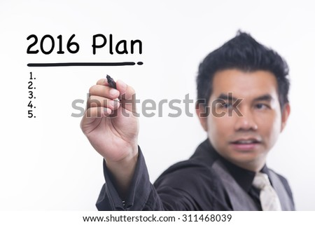Young business man draws a 2016 plan - stock photo