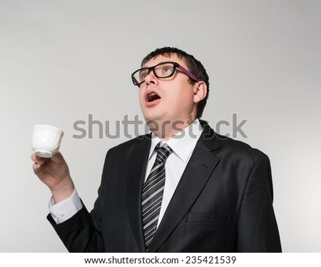 Young Business Man Drinking a Cup of Coffee or Tea