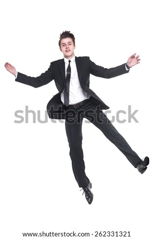 Young business man flying isolated on white back ground  - stock photo