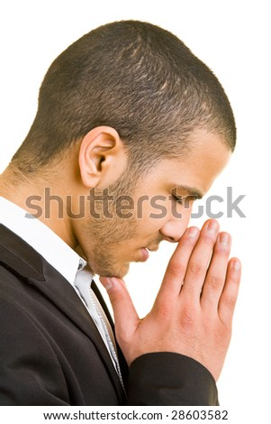 Young business man folding his hands for a prayer - stock photo