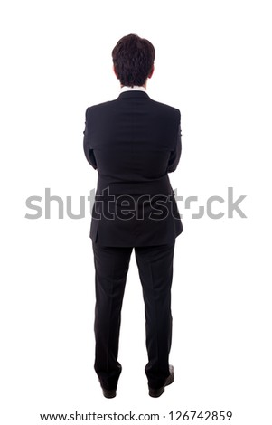 Young business man from the back waiting for something over a white background - stock photo