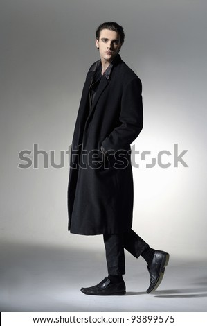 young business man full body walking on light background - stock photo