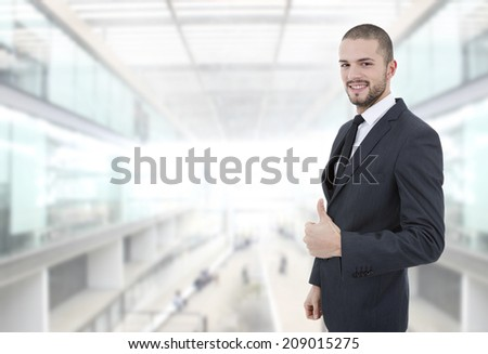 young business man going thumb up at the office - stock photo