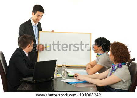 Young business man hav ing presentation on blank board at meeting - stock photo