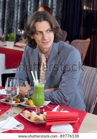 Young business man have a resy in restaurant - stock photo