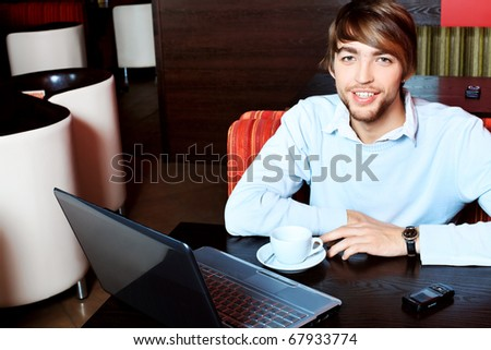 Young business man having a break at a cafe. - stock photo