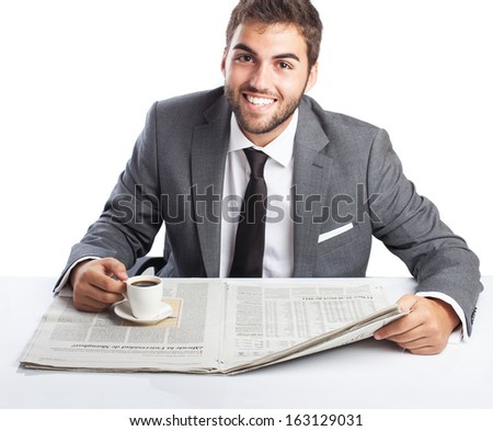young business man having a break, reading a newspaper and drinking a coffee isolated on white - stock photo