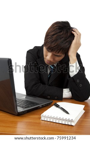 Young  business man having stress or a headache - stock photo