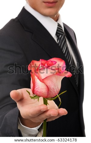 Young business man hold rose. Isolated on white - stock photo
