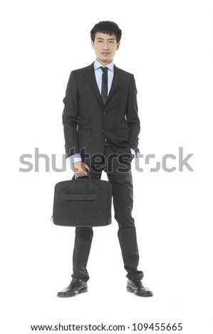 Young business man holding a laptop bag