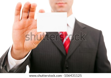 young business man holding blank business card, isolated on white - stock photo