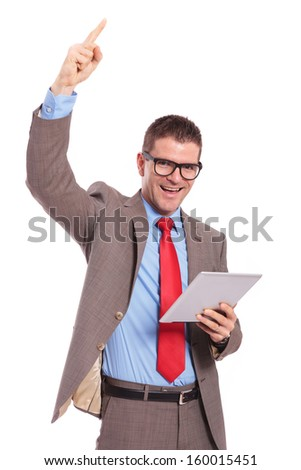 young business man holding his tablet and cheering with a finger in the air. on a white background - stock photo
