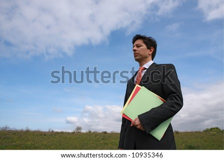 Young business man holding three colorful dossier ready to working - stock photo