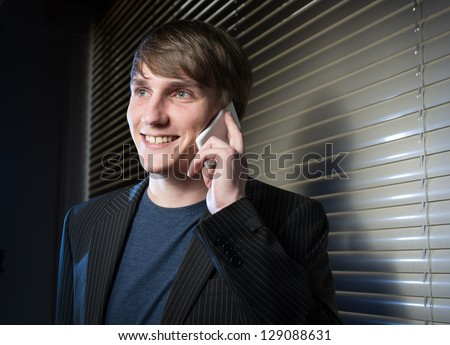young business man in a dark office - stock photo