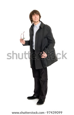 Young business man in a raincoat with a briefcase.