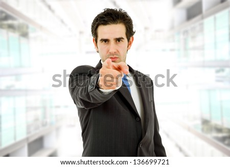 young business man in a suit pointing with his finger - stock photo