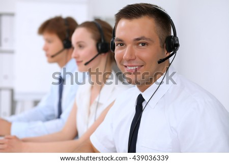 Young business man in headset. Call center - stock photo