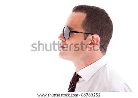 young business man in profile, with sunglasses isolated on white, studio shot - stock photo
