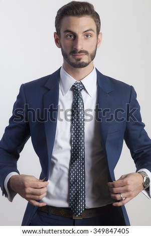 Young Business Man in Suit Opening Jacket