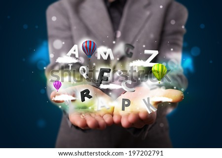 Young business man in suit presenting magical clouds with letters and balloons concept