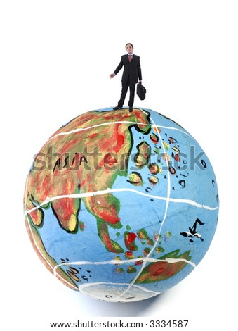 young business man in the top of a globe - stock photo