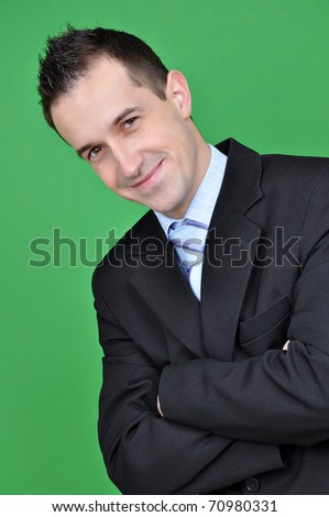 Young business man isolated on green background - stock photo