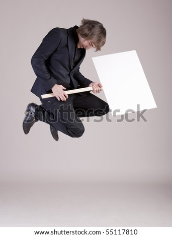 Young business man jumping with a space box - stock photo