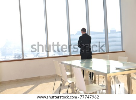 young business man lawyer with laptop alone in big bright   conference room - stock photo
