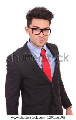 young business man looking at the camera with a curageous look, on a white background