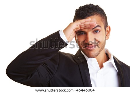 Young business man looking into the distance - stock photo