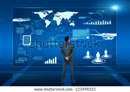 young business man looking on futuristic virtual screen - stock photo