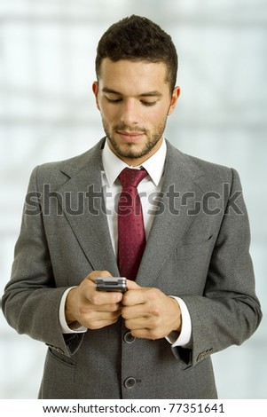 young business man looking to his phone - stock photo